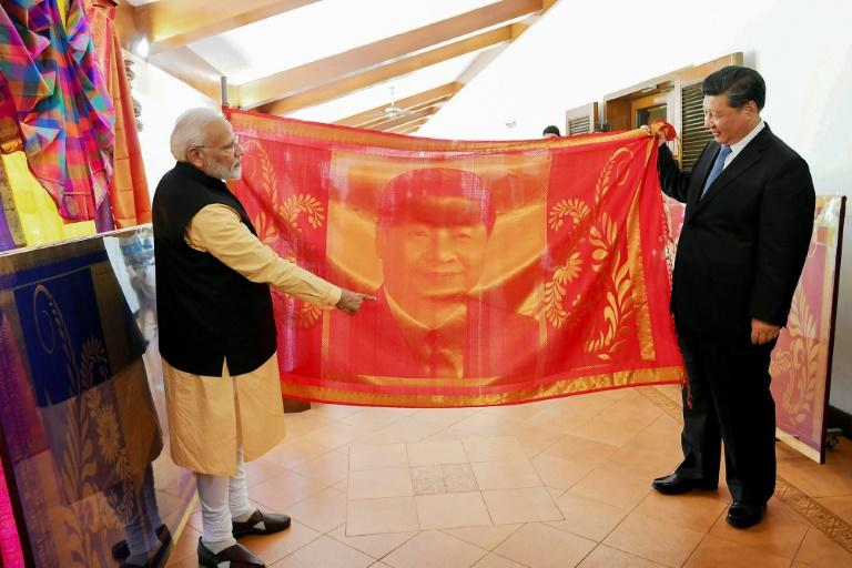 """Xi and Modi exchanged gifts at their summit where the Chinese president said they had """"candid discussions as friends"""" (AFP Photo/Handout)"""