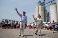 FILE PHOTO: Democratic presidential hopeful Sen. Bernie Sanders and his wife Jane Sanders wave as they march during the Independence Day Parade in Waukee, Iowa