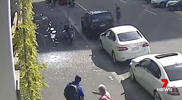 Two pedestrians were just metres from being covered in the falling shards. Photo: 7 News