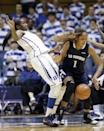 Duke's Elizabeth Williams, left, guards Old Dominion's Shae Kelley (1) during the second half of an NCAA college basketball game in Durham, N.C., Thursday, Jan. 2, 2014. Duke won 87-63. (AP Photo/Gerry Broome)