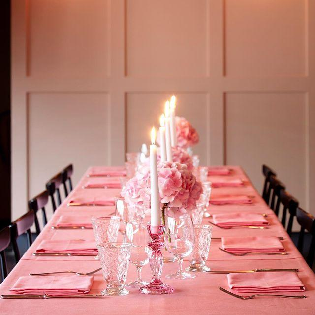 """<p>A plus-side to limited guests is hosting them in venues that would've been out of the question in previous years. The idea of a wedding breakfast at a favourite restaurant has long had cool-girl appeal (think Sex And The City's Carrie Bradshaw and Big's sit-down lunch), but for many, the amount of guests somewhat vetoed that plan. That is, until now. </p><p>'Couples are selecting their favourite restaurants to have the wedding breakfast,' Bernadette Chapman, owner of the <a href=""""https://www.ukawp.com/"""" rel=""""nofollow noopener"""" target=""""_blank"""" data-ylk=""""slk:UK Alliance of Wedding Planning (UKAWP)"""" class=""""link rapid-noclick-resp"""">UK Alliance of Wedding Planning (UKAWP)</a>, tells ELLE UK, 'whereas this would have been out of their budget if the wedding was larger'.</p><p>After months of access to hospitality being limited, hosting an intimate dinner or lunch after your vows in 2021 is all the more enticing.</p><p>We're looking to private dining rooms like East London's <a href=""""https://www.bistrotheque.com/"""" rel=""""nofollow noopener"""" target=""""_blank"""" data-ylk=""""slk:Bistroteque"""" class=""""link rapid-noclick-resp"""">Bistroteque</a>'s 'Pink Dining Room' for an intimate feel.</p><p><a href=""""https://www.instagram.com/p/CFeRyNGHujS/"""" rel=""""nofollow noopener"""" target=""""_blank"""" data-ylk=""""slk:See the original post on Instagram"""" class=""""link rapid-noclick-resp"""">See the original post on Instagram</a></p>"""