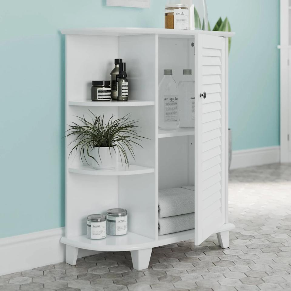 """<p>This <a href=""""https://www.popsugar.com/buy/Floor-Cabinet-Decorative-Shelves-Shutter-Door-472170?p_name=Floor%20Cabinet%20With%20Decorative%20Shelves%20and%20Shutter%20Door&retailer=target.com&pid=472170&price=95&evar1=casa%3Aus&evar9=46417510&evar98=https%3A%2F%2Fwww.popsugar.com%2Fhome%2Fphoto-gallery%2F46417510%2Fimage%2F46419066%2FFloor-Cabinet-Decorative-Shelves-Shutter-Door&list1=target%2Cfurniture%2Cbathrooms&prop13=api&pdata=1"""" rel=""""nofollow"""" data-shoppable-link=""""1"""" target=""""_blank"""" class=""""ga-track"""" data-ga-category=""""Related"""" data-ga-label=""""https://www.target.com/p/floor-cabinet-with-decorative-shelves-and-shutter-door-river-ridge/-/A-76578758?preselect=54649604#lnk=sametab"""" data-ga-action=""""In-Line Links"""">Floor Cabinet With Decorative Shelves and Shutter Door</a> ($95) has five roomy shelves, which will give you all the room you need for lotions, towels, shampoo, and more.</p>"""