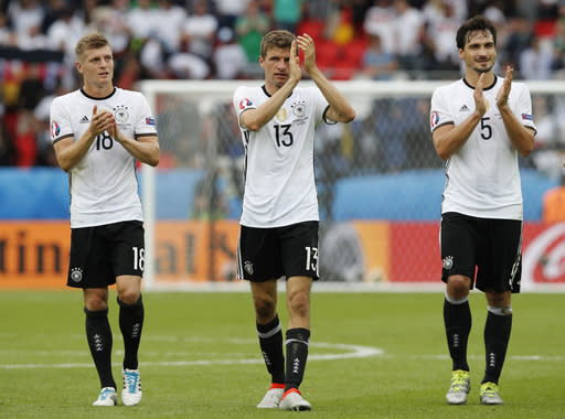 FILE - In this June 21, 2016 file photo Germany's Toni Kroos, left, Thomas Mueller, center, and Mats Hummels applaud fans at the end of the Euro 2016 Group C soccer match between Northern Ireland and Germany at the Parc des Princes stadium in Paris, France. Germany coach Joachim Loew is brimming with confidence just over three weeks before what he calls the countrys golden generation begins its World Cup defense against Mexico. (AP Photo/Christophe Ena, file)
