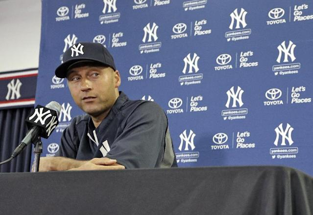 New York Yankees shortstop Derek Jeter looks at a reporter after a cell phone rang during a news conference Wednesday, Feb. 19, 2014, in Tampa, Fla. Jeter has announced he will retire at the end of the 2014 season. (AP Photo/Chris O'Meara)