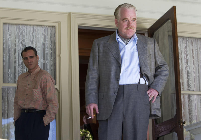 """FILE - This undated file handout film image released by The Weinstein Company shows Joaquin Phoenix, left, and Philip Seymour Hoffman in a scene from """"The Master."""" On Sunday, Dec. 9, 2012, the Los Angeles Film Critics Association announced their picks for movies of 2012. The French old-age drama """"Amour"""" was chosen as the year's best film. The 1950s cult drama """"The Master"""" earned three awards: best director for Paul Thomas Anderson, best actor for Joaquin Phoenix and supporting actress for Amy Adams. """"The Master"""" also was chosen as best-picture runner-up. """"Amour"""" star Emmanuelle Riva shared the best-actress honor in a tie with Jennifer Lawrence for the lost-soul romance """"Silver Linings Playbook."""" Newcomer Dwight Henry was chosen as supporting actor for the low-budget critical darling """"Beasts of the Southern Wild."""" (AP Photo/The Weinstein Company, File)"""