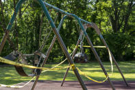 """FILE - In this Saturday, May 30, 2020 file photo, the playground at the historic Glen Echo Park remains closed because of restrictions related to the coronavirus pandemic, in Glen Echo, Md., near Washington. Lawmakers in in the state used words like """"stunning"""" and """"unique"""" to describe how federal aid helped reshape their budget situation. Maryland's record $52.4 billion budget for its new fiscal year provides bonuses to state workers, boosts payments to the poor, builds parks and playgrounds in every county, and still sets aside about $2 billion for savings. (AP Photo/J. Scott Applewhite, File)"""