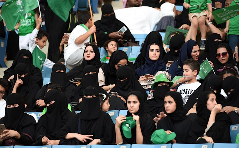 Women commemorate the anniversary of Saudi Arabia's founding at King Fahd International Stadium in Riyadh on Sept. 23, 2017. Strict rules on public segregation of the sexes have effectively barred women in Saudi Arabia from entering sports arenas. (FAYEZ NURELDINE/AFP/Getty Images)