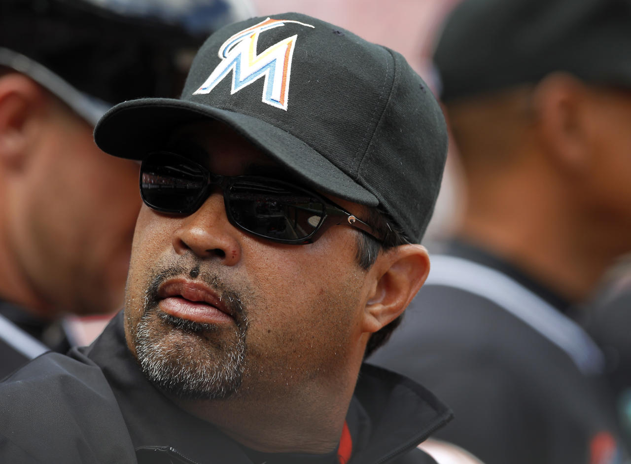 Miami Marlins manager Ozzie Guillen looks over his shoulder during the home opener baseball game with the Philadelphia Phillies Monday, April 9, 2012, in Philadelphia. Five games into his tenure with the Marlins, Guillen is returning to Miami on Tuesday to explain himself as a backlash builds regarding favorable comments he made about Fidel Castro. (AP Photo/Alex Brandon)
