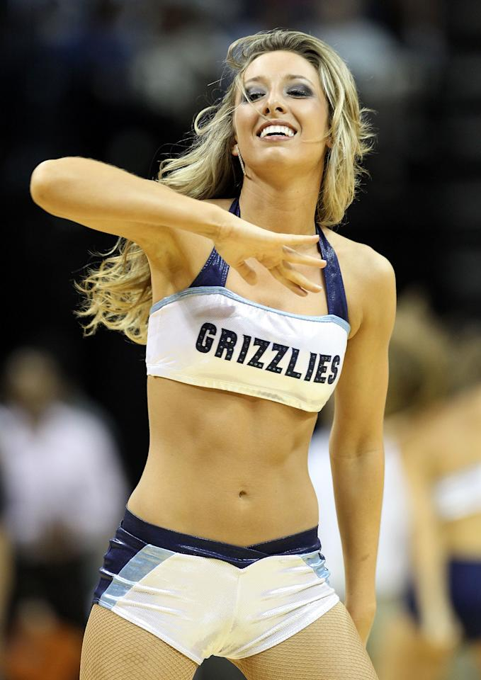 MEMPHIS, TN - APRIL 21: A Memphis Grizzlies cheerleader performs during the NBA game against the Portland Trail Blazers  at FedExForum on April 21, 2012 in Memphis, Tennessee. NOTE TO USER: User expressly acknowledges and agrees that, by downloading and or using this photograph, User is consenting to the terms and conditions of the Getty Images License Agreement.  (Photo by Andy Lyons/Getty Images)