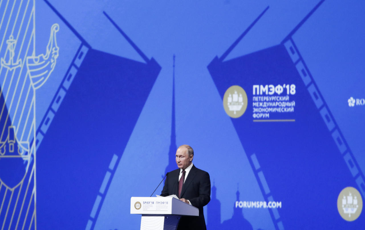Russian President Vladimir Putin speaks at the St. Petersburg International Economic Forum in St. Petersburg, Russia, Friday, May 25, 2018. (AP Photo/Dmitri Lovetsky)