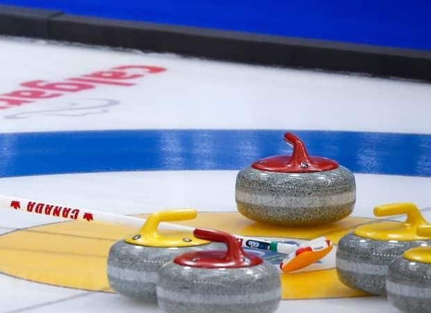 The women's world curling championship was put on pause after a series of positive COVID-19 cases were detected Sunday amongst the broadcast crew covering the games in Calgary. (Jeff McIntosh/The Canadian Press  - image credit)