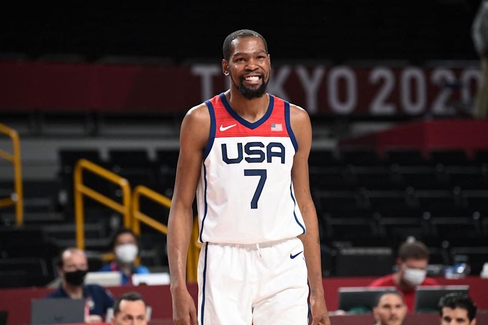 <p>USA's Kevin Wayne Durant reacts during the men's preliminary round group A basketball match between Iran and USA of the Tokyo 2020 Olympic Games at the Saitama Super Arena in Saitama on July 28, 2021. (Photo by Aris MESSINIS / AFP) (Photo by ARIS MESSINIS/AFP via Getty Images)</p>