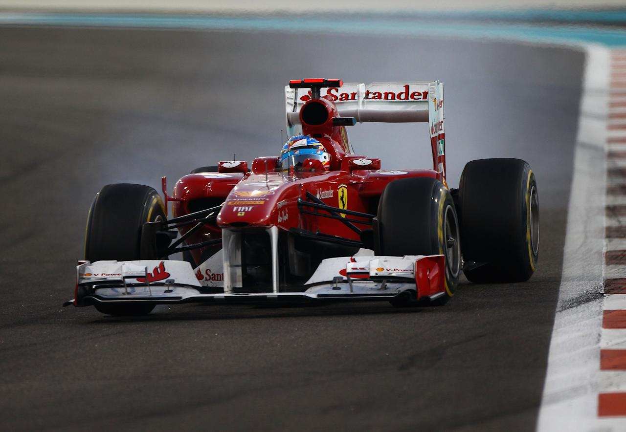 ABU DHABI, UNITED ARAB EMIRATES - NOVEMBER 13:  Fernando Alonso of Spain and Ferrari drives on his way to finishing second during the Abu Dhabi Formula One Grand Prix at the Yas Marina Circuit on November 13, 2011 in Abu Dhabi, United Arab Emirates.  (Photo by Clive Mason/Getty Images)