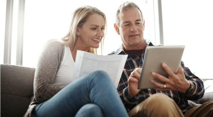 Couple using their online trading app