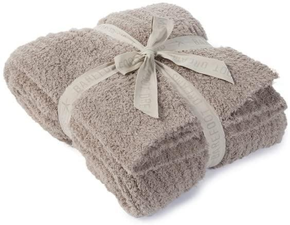 <p>Customers love this plush <span>Barefoot Dreams CozyChic Ribbed Throw Blanket</span> ($175).</p>