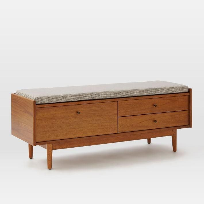 <p>If you're looking for something with some extra style, then the <span>West Elm Mid-Century Entryway Bench</span> ($599) is for you.</p>