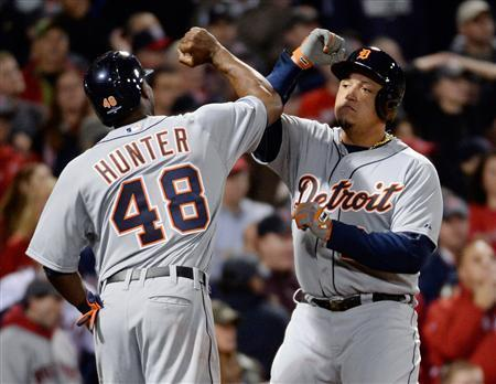 Oct 19, 2013; Boston, MA, USA; Detroit Tigers players Torii Hunter (left) and Prince Fielder celebrate after both scoring runs against the Boston Red Sox during the sixth inning in game six of the American League Championship Series playoff baseball game at Fenway Park. Mandatory Credit: Robert Deutsch-USA TODAY Sports