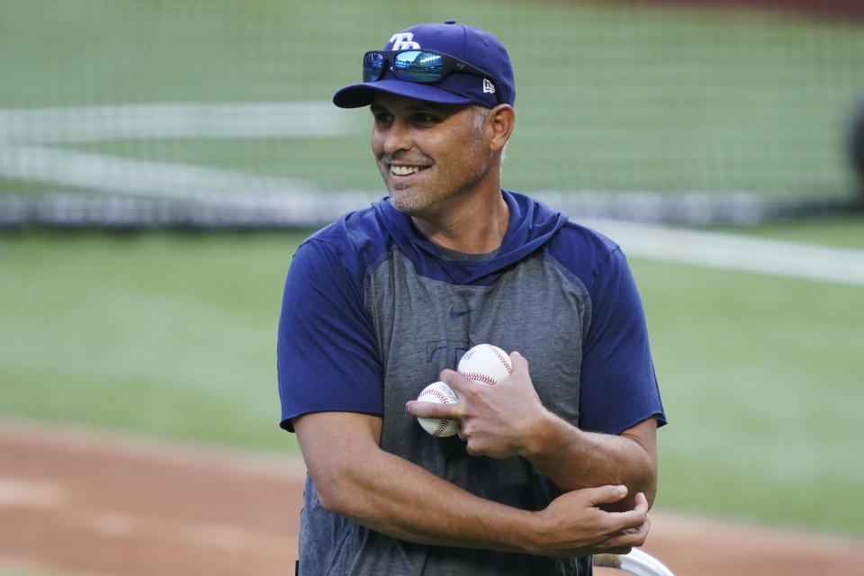 Tampa Bay Rays manager Kevin Cash throws batting practice before Game 1 of the baseball World Series Series against the Los Angeles Dodgers Tuesday, Oct. 20, 2020, in Arlington, Texas. (AP Photo/Tony Gutierrez)