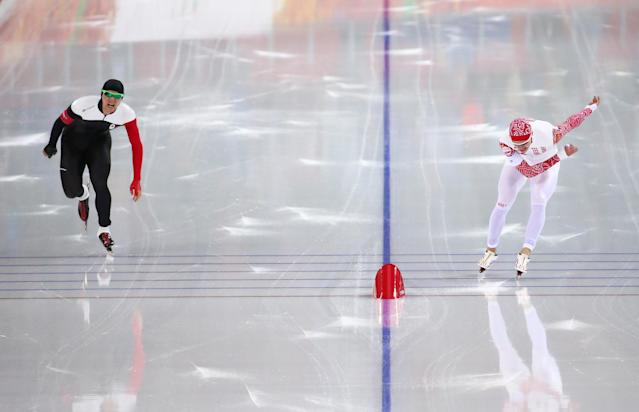 SOCHI, RUSSIA - FEBRUARY 12: Vincent De Haitre of Canada and Denis Yuskov of Russia compete during the Men's 1000m Speed Skating event during day 5 of the Sochi 2014 Winter Olympics at at Adler Arena Skating Center on February 12, 2014 in Sochi, Russia. (Photo by Streeter Lecka/Getty Images)