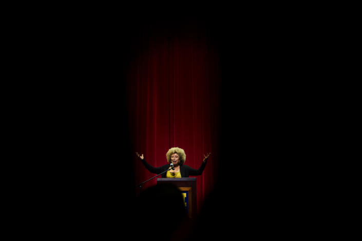 FILE- In this Feb. 19, 2015, file photo, Angela Davis, author, educator and iconic civil rights activist, speaks during her visit to the University of Michigan-Flint, in Flint, Mich. An Alabama civil rights museum is apologizing for the discord that resulted from its decision to rescind a human rights award to Davis. A statement issued Monday, Jan. 14, 2019, by the Birmingham Civil Rights Institute says the organization created division and compromised its good name with the move. The statement says board members accept responsibility for what happened and are sorry. (Jake May/The Flint Journal via AP, File)