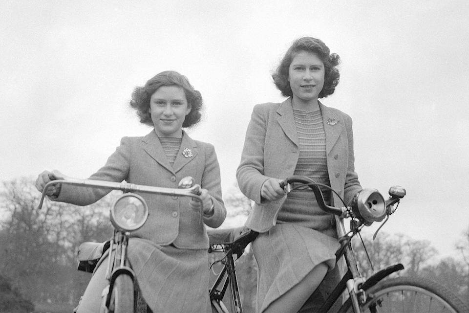 <p>Here, Queen Elizabeth (right) and her lil' sis, Princess Margaret, are twinning again as they take a leisurely bike ride around Windsor, England.</p>