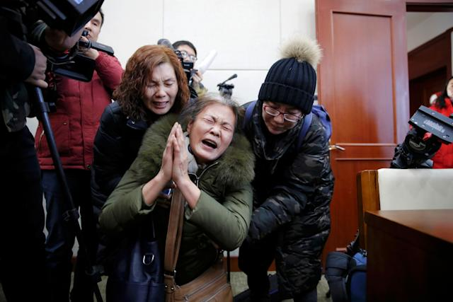 MH370 families mourn