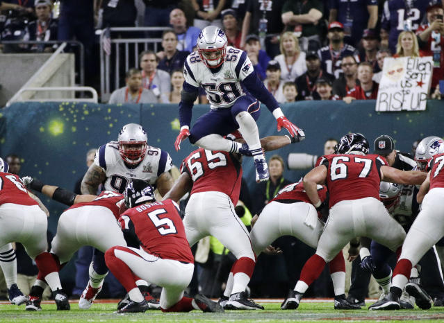 Flying high: Shea McClellin leaped over the line of scrimmage in Super Bowl LI to try to block a field goal. (AP)