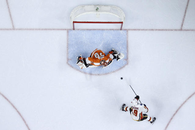 Calgary Flames' Matthew Tkachuk (19) scores a goal against Philadelphia Flyers' Carter Hart (79) during a shootout in an NHL hockey game, Saturday, Nov. 23, 2019, in Philadelphia. Calgary won 3-2. (AP Photo/Matt Slocum)