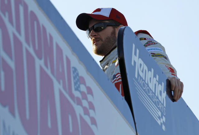 Dale Earnahrdt Jr. watches from the top of his transporter during practice for Sunday's NASCAR Daytona 500 Sprint Cup Series auto race at Daytona International Speedway in Daytona Beach, Fla., Wednesday, Feb. 19, 2014. (AP Photo/Terry Renna)