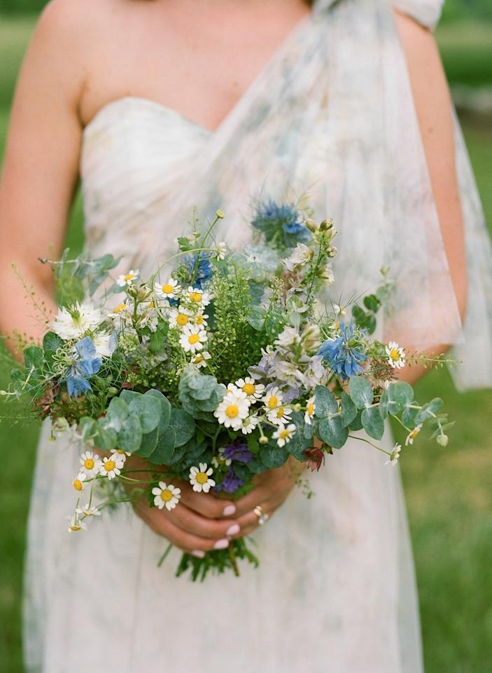 "For this <a rel=""nofollow"" href=""https://www.brides.com/story/an-at-home-wedding-in-the-virginia-countryside?mbid=synd_yahoo_rss"">carefree wedding</a> in the hills of Virginia, Sweet Root Village made bouquets of soft pink astrantia, baby's breath, eucalyptus, lavender larkspur, baby white daisies, nigella, and blue thistle."