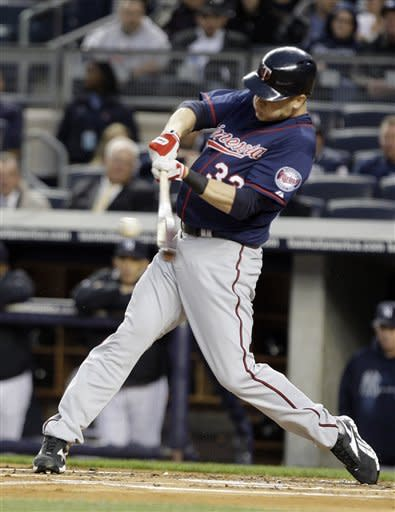 Minnesota Twins' Justin Morneau (33) hits a two-run home run against the New York Yankees at Yankee Stadium in New York, Wednesday, April 18, 2012. (AP Photo/Frank Franklin II)