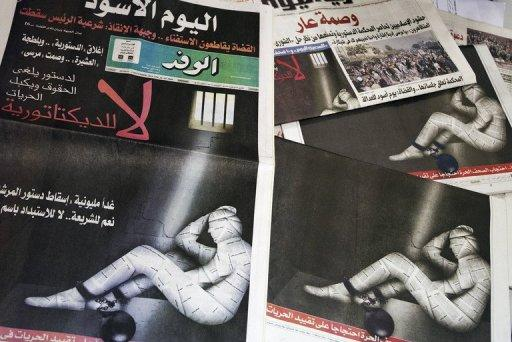"Monday's front pages displayed the slogan ""No to dictatorship"" with the image of a person wrapped in newspaper"