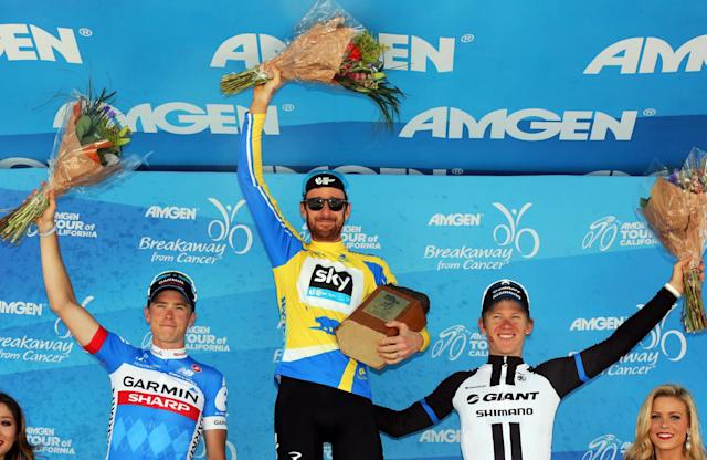 Bradley Wiggins, of Great Britain, center, the overall winner of the final stage of the Tour of California cycling race, in joined by second placed Dennis Rohan, of Australia, left, and third place winner Lawson Craddock Sunday, May 18, 2014. in Thousand Oaks, Calif. Craddock also took best young cyclist honors.(AP Photo/Reed Saxon)
