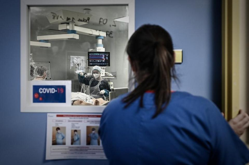 A medical personnel attends a Covid-19 patient at the reanimation section of the Robert Boulin hospital in Libourne, southwestern France, on November 6, 2020.