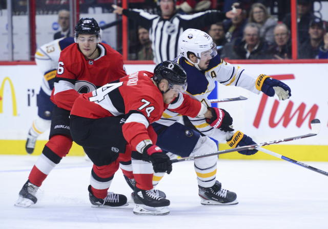 Ottawa Senators defenseman Mark Borowiecki (74) pushes Buffalo Sabres left wing Marcus Johansson (90) off the puck during the first period of an NHL hockey game Monday, Dec. 23, 2019, in Ottawa, Ontario. (Sean Kilpatrick/The Canadian Press via AP)