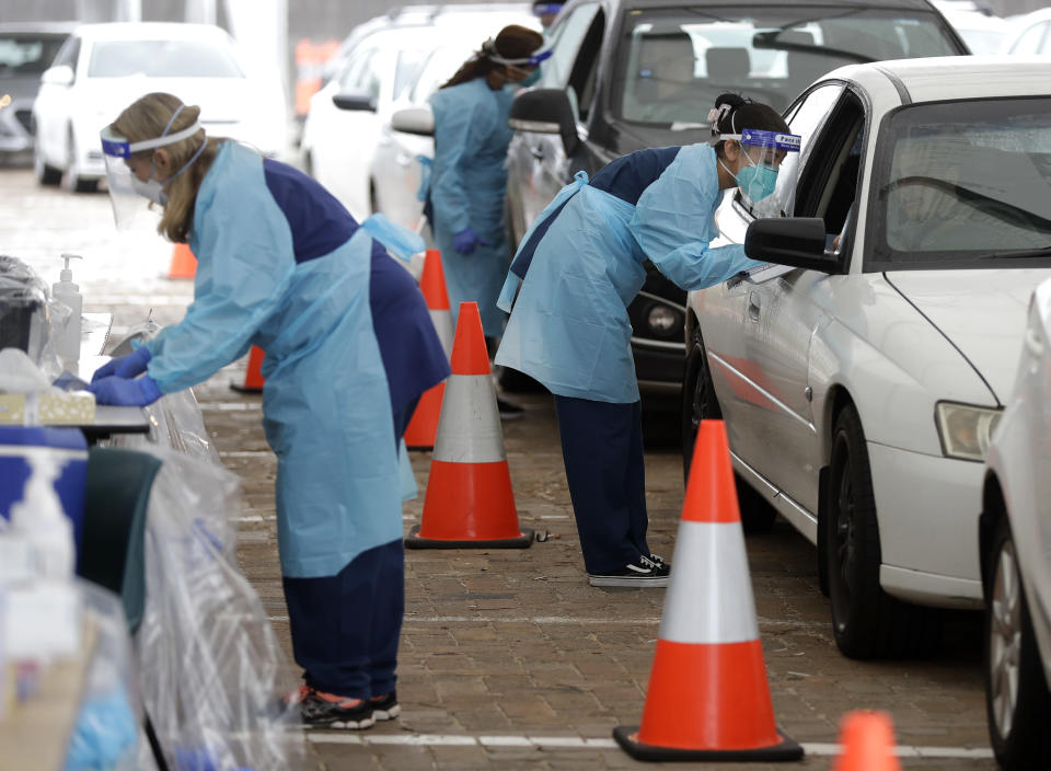 People attend a drive through COVID-19 testing station at a beach in Sydney, Australia, Saturday, Dec. 19, 2020. Sydney's northern beaches will enter a lockdown similar to the one imposed during the start of the COVID-19 pandemic in March as a cluster of cases in the area increased to more than 40. (AP Photo/Mark Baker)