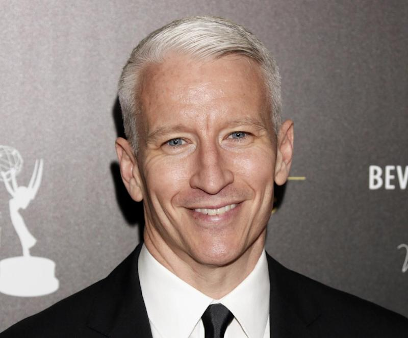 FILE - This June 23, 2012 file photo shows CNN's Anderson Cooper arrives at the 39th Annual Daytime Emmy Awards at the Beverly Hilton Hotel in Beverly Hills, Calif.  The gay advocacy group GLAAD says Madonna will present CNN's Anderson Cooper with an award for openly gay media professionals. GLAAD announced Saturday, Sept. 2, 2013,  that Cooper will receive its Vito Russo Award at the 24th Annual GLAAD Media Awards in New York City on March 16.(Photo by Todd Williamson/Invision/AP, file)