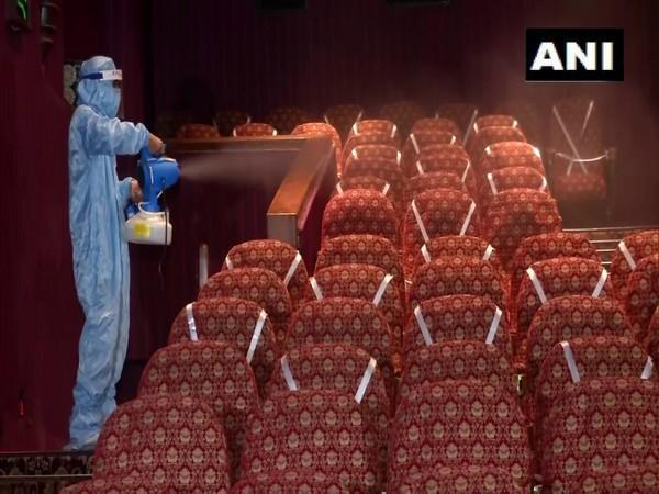 Seats at a movie theatre being sanitised. (Photo/ANI)