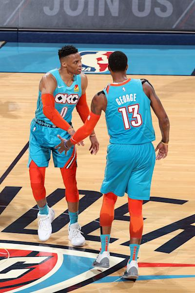 OKLAHOMA CITY, OK - APRIL 19: Russell Westbrook #0 and Paul George #13 of the Oklahoma City Thunder high five during Game Three of Round One of the 2019 NBA Playoffs against the Portland Trail Blazers on April 19, 2019 at Chesapeake Energy Arena in Oklahoma City, Oklahoma. (Photo by Joe Murphy/NBAE via Getty Images)