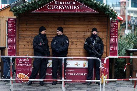 FILE PHOTO: Police stand guard at the Kaiser-Wilhelm-Gedaechtniskirche Christmas market in Berlin
