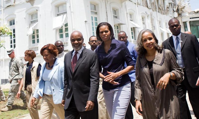 René Préval inspecting Haiti's earthquake damage in 2010 with Michelle Obama and his wife, Elisabeth, second right.