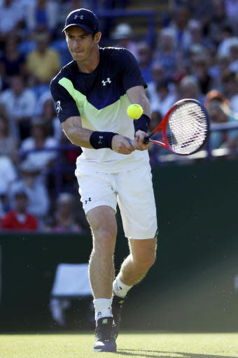 Great Britain's Andy Murray returns the ball to Switzerland's Stan Wawrinka on day two of the Nature Valley International at Devonshire Park, Eastbourne, Monday June 25, 2018. (Steven Paston/PA via AP)