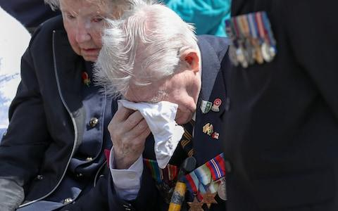 D-Day veteran Jimmy Ockendon wipes away tears during service - Credit: Andrew Matthews/PA