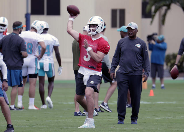 Jim Caldwell (right) was expected to take a large role in the development of quarterback Josh Rosen (3). (AP Photo/Lynne Sladky)