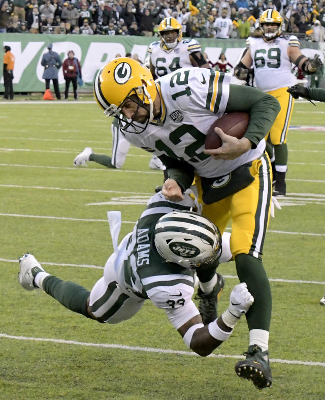 Green Bay Packers quarterback Aaron Rodgers (12) is tackled by New York Jets strong safety Jamal Adams (33) during the second half of an NFL football game, Sunday, Dec. 23, 2018, in East Rutherford, N.J. (AP Photo/Bill Kostroun)