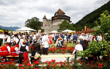 People attend a party celebrating Liechtenstein's 300th birthday in the gardens of Schloss Vaduz castle in Vaduz