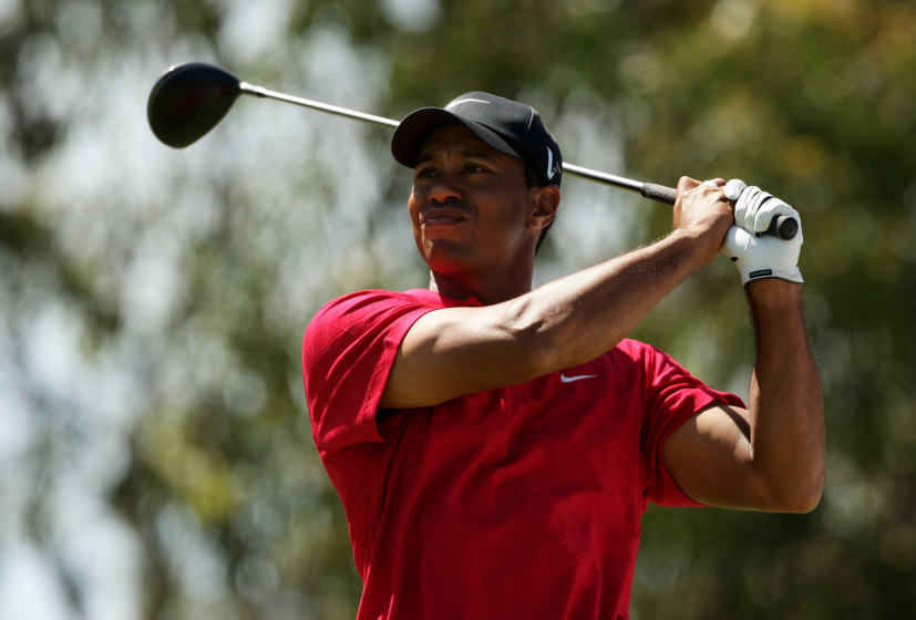 MELBOURNE, AUSTRALIA - NOVEMBER 15: Tiger Woods of the USA tees off on the 12th hole.