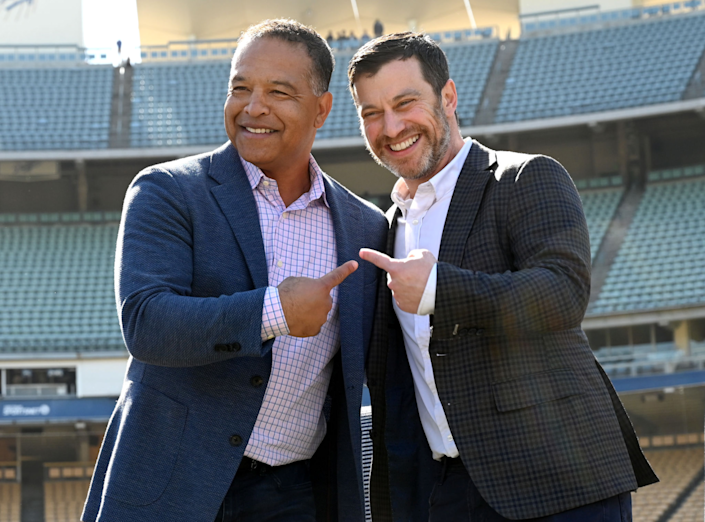 Dodgers manager Dave Roberts, left, and Dodgers president of baseball operations Andrew Friedman.
