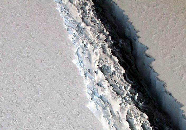 An aerial view of the Antarctic Peninsula's Larsen C ice shelf. According to NASA, IceBridge scientists measured the Larsen C fracture to be about 70 miles long, more than 300 feet wide and about a third of a mile deep. (Photo: John Sonntag/NASA via AP)