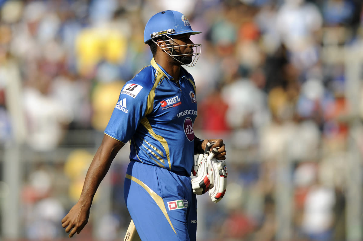 Kieron Pollard of Mumbai Indians walks back after getting out during match 49 of the Pepsi Indian Premier League ( IPL) 2013  between The Mumbai Indians and the Chennai SUperkings held at the Wankhede Stadium in Mumbai on the 5th May 2013 ..Photo by Pal Pillai-IPL-SPORTZPICS  ..Use of this image is subject to the terms and conditions as outlined by the BCCI. These terms can be found by following this link:..https://ec.yimg.com/ec?url=http%3a%2f%2fwww.sportzpics.co.za%2fimage%2fI0000SoRagM2cIEc&t=1490472070&sig=W8982eeyXdYGs2JhZw6taQ--~C